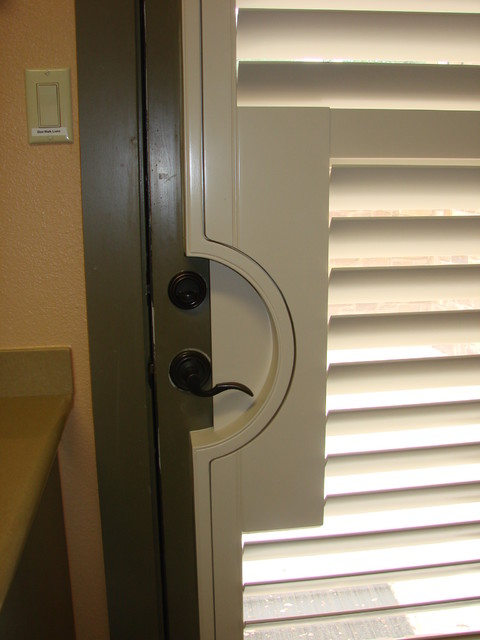 Shutter on Door with Round Door Handle Cut Out traditional-window-blinds