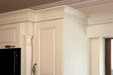 cream painted traditional-kitchen-cabinets