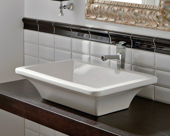 "Scarabeo - Gorgeous Rectangular Ceramic Vessel Sink with Curved Sides - This gorgeous rectangular white ceramic vessel sink is designed and made in Italy by Scarabeo. Sink features curved sides, includes overflow, and comes with no faucet holes. Sink dimensions: 23.60"" (width), 5.70"" (height), 16.10"" (depth)"