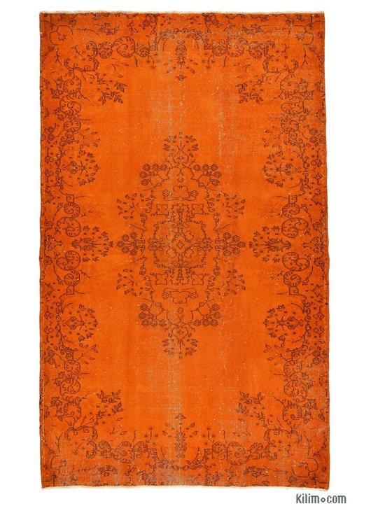 Over-dyed Anatolian Vintage Rug - This piece is an Over-dyed Anatolian Vintage Rug created by first neutralizing the colors and then over-dying with orange to achieve a contemporary effect and bring old hand-made rugs back to life. The result is almost like an abstract painting.