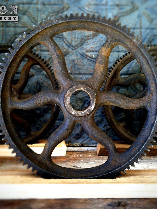 """Antique Industrial Gear Decor - Turn-of-the-century numbered gear of cast iron in a very dynamic industrial style! Luscious old patina with its original black painted finish. Marked: '86. Sits in a rustic reclaimed lumber display stand. 8.25"""" diameter."""