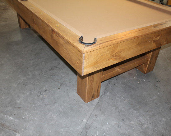 Michigan Made Custom Pool Tables - Add a beautifully custom made McClure pool table to your basement and you will forever be happy. Made with one hundred percent North American hard maple wood, this table exudes a unique contemporary style. Not only will this be a focal point of your basement but it will also provide entertainment for you and your friends and family.