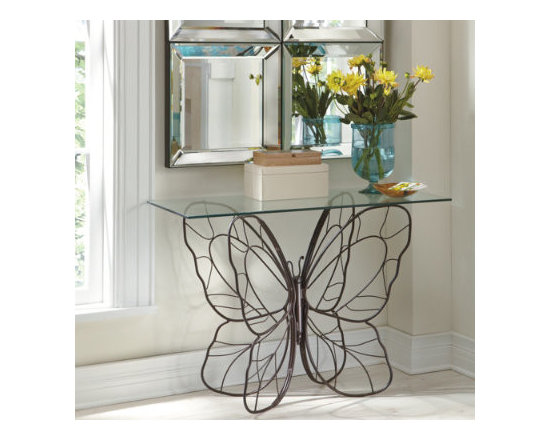 """Grandin Road - Monarch Yellowfly Console Table - Delightfully delicate-looking wings are actually forged iron. Lustrous, hand-rubbed bronze finish. Powdercoated for superior durability. Beautiful, unobtrusive glass tabletop. """"When a piece with real character encounters a space, it soars to new heights. Let us introduce our Monarch Table."""" — GRANDIN ROAD EDITORS Our Monarch Butterfly Console Table has an invaluable presence, like that of a fine furniture piece costing hundreds more. This table is crafted with meticulous attention to detail.. . . ."""