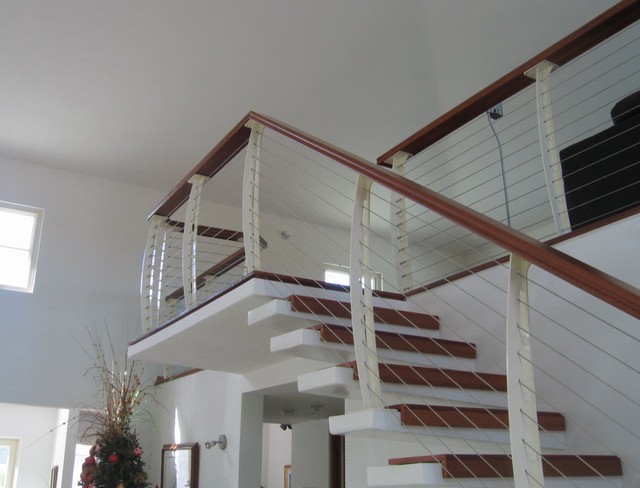 White Interior Cable railing on Cantilever Stairs contemporary-staircase