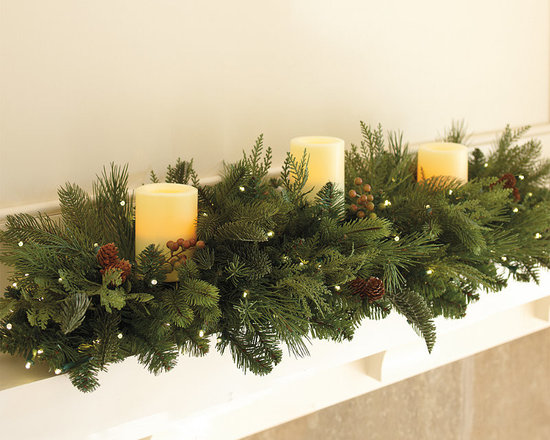 """Frontgate - Majestic Cordless Candle Centerpiece Christmas Decor - Illuminated by three 3"""" x 6"""" battery-operated LED candles (included). Uses 6 D batteries (not included). Lights for up to 90 hours. To maximize fullness, greenery will need to be shaped. Whether gracing a dining table or mantel, this battery-operated Majestic Cordless Candle Centerpiece makes a dramatic statement, without the safety worries of a wax candle centerpiece. Our exclusive centerpiece sets a grand holiday mood with natural-looking fir, pine, and cedar boughs.  .  .  . ."""