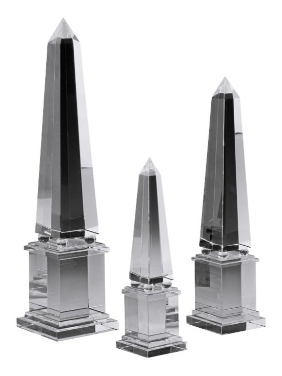 """Inviting Home - crystal obelisks (set of three) - set of three solid crystal obelisks 3"""" x 12-1/4""""H; 3-3/4"""" x 16-1/4""""H; 4-3/4"""" x 20""""H Incorporating Obelisks into Your Decor. The clean lines and simple elegance that crystal obelisks embody means that they are the ideal artistic touch in many types of room. A larger piece of this nature can complement a more significant room such as a living room and serve as a focal point that naturally draws the eye. Smaller versions of the crystal obelisks could readily serve as a harmonious part of a grouped display lending an exotic air to the scene and imparting the healing properties of crystal as well. Some designers and many mystics recommend crystal obelisks as an accessory in the bedroom where the natural properties of crystal can work their magic during restful slumber. Opening your eyes in the morning and letting your gaze fall upon the simple beauty of an obelisk can get your day off to an excellent start as well."""