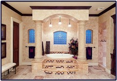Large Master Bathroom with Greek Style Colummns and Travertine Tile
