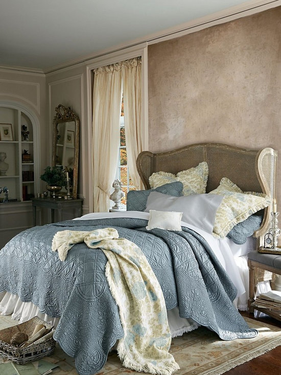 Pont d'Arc Quilt - Elegant and oh-so-sophisticated, our Pont d'Arc quilt is a celebration of opulent texture and careful attention to detail. Soft and silky with a subtle sheen, it's masterfully quilted by hand in a double-lattice motif. An intricate, vermicelli-stitched border with floral medallions and gentle scalloped edging completes the beautiful, season-spanning design. Polyester.