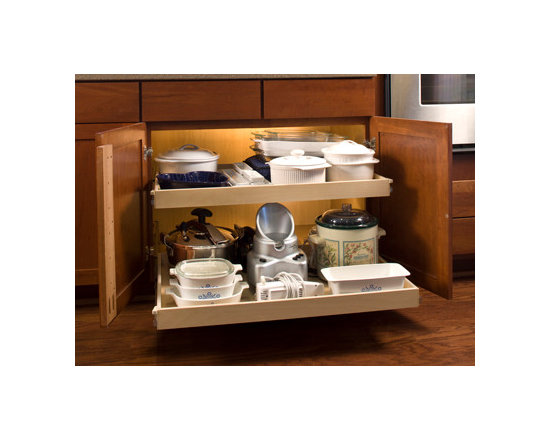 ShelfGenie Glide-Out Shelves - Removing the center stile from a kitchen cabinets literally opens everything up.  The look is seamless from the outside, but once you open the cabinet door you have unobstructed access to a nice, wide pull out shelf.  Ideal for storing large items.