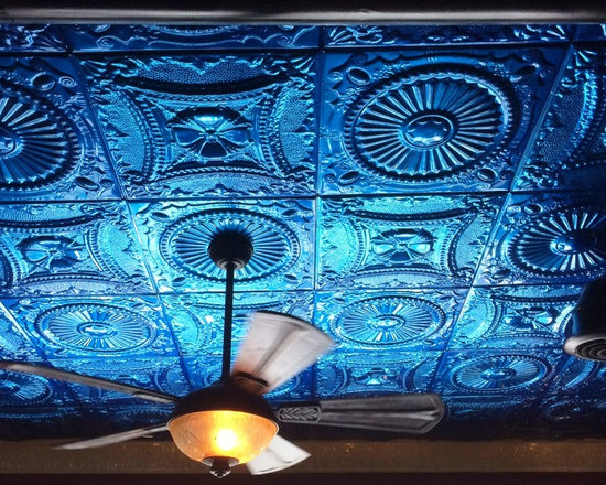 Tin Ceiling Tiles in Bright Colors - Tin ceiling tiles don't have to come in standard metallic. These brilliant blue ceiling tiles in alternating patterns make a uniquely interesting focal point.