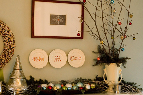 a festive holiday display that features minimalist pieces and colorful ornaments