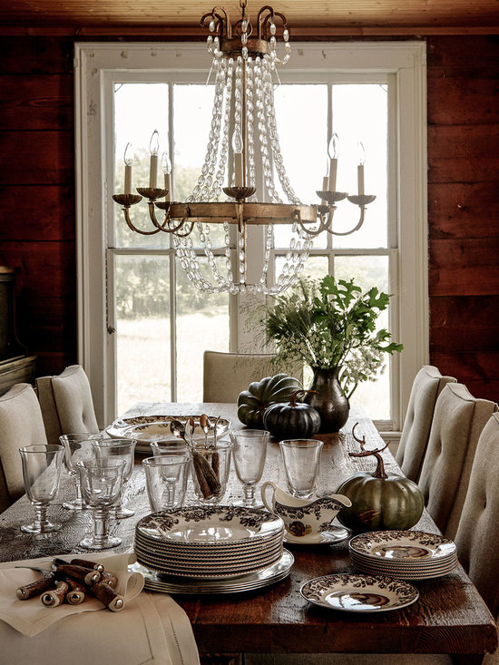 Lighting - Cascading chains of seeded glass beads come together with gilded iron in a handcrafted chandelier that dazzles the eye.