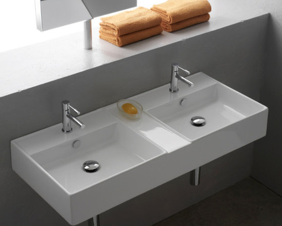 "Scarabeo - Elegant Double Wall Mounted or Vessel White Ceramic Sink - Elegant white ceramic rectangular bathroom sink made in Italy by Scarabeo. This twin bathroom sink with overflow can be either wall mounted or an above counter vessel sink. It has an option for 2 faucet holes (as shown), no holes, or 6 holes. Sink dimensions: 41.30"" (width), 5.50"" (height), 18.10"" (depth)"