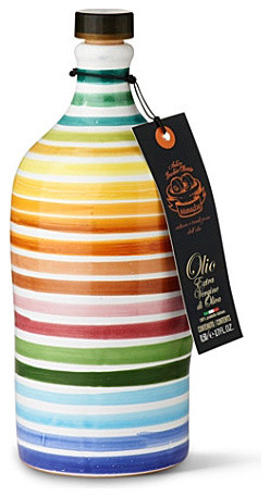 Extra virgin olive oil in hand–painted bottle tabletop