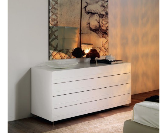Cattelan Italia - Cattelan Italia   Dyno Dresser - Made in Italy by Cattelan Italia.Elegance in simplicity and superior construction make up the modest yet modern architecture of the Dyno Dresser. The solid premium wood frame of this low dresser cradles eight wide spacious drawers, enabling easy storage and organization of multiple types of garments. A facade of soft leather adds an element of luxury to the furniture's look. Wide stainless steel feet set at a slanted position make for a stylish support mechanism. Personalize the look of your bedroom by selecting from a range of wood lacquers as well as leather colors and textures, making decorating effortless.