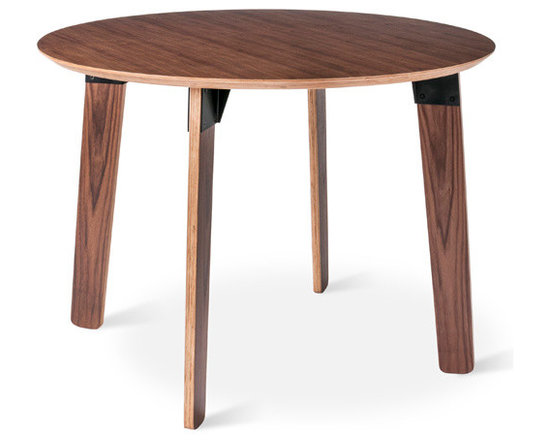 Gus Modern - Sudbury Dining Table , Black Powder Coat Walnut, Round - The Sudbury Table by Gus Modern is a study in contrasts. Organic forms joined together by industrial fittings. Warm wood grain stands out against sleek steel. Scaled for smaller spaces, this table�۪s rounded shapes create a relaxed vibe that�۪s perfect for a modern dining area. It features exposed ply legs and beveled tabletop with fittings made from durable, powder-coated steel. Available in walnut with black brackets, or natural oak with white.