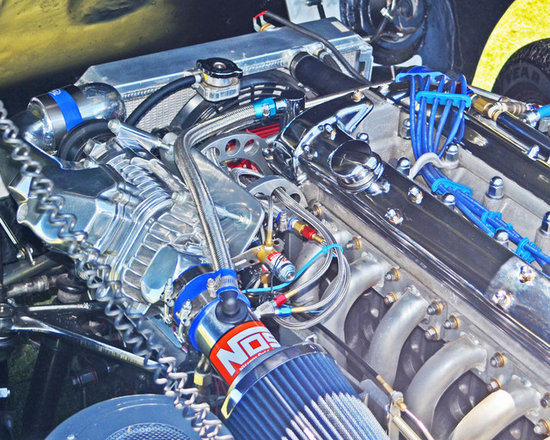 """www.WilliamBrionart.com photo gallery - Photograph by William Brion, """"NOS Powered"""", of the racing engine of a classic car at the Concours D'Elegance in Dana Point in CA. I took the photo and pushed the color intensity and the saturation to emphasize the beauty of good design applied to efficiently utilize limited space within the engine compartment of cars. ( Gallery 5 )"""