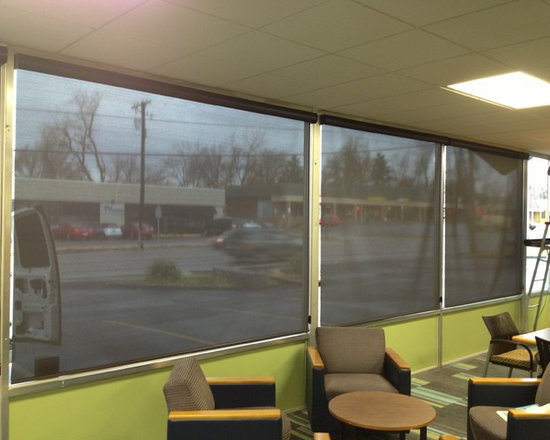 Designer Roller Shades by Alta - Kirkwood, Mo - Two Blind Guys outfitted these large commercial windows with Roller Shades in a 5% fabric by Alta. They made a world of a difference in cutting their energy bills down.