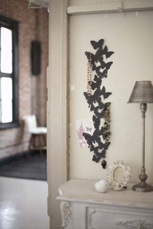 Black metal butterfly wall hanger for photos and for Home decor and accents