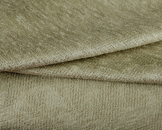 Luster Upholstery Fabric in Khaki - Luster Upholstery Fabric in Khaki. A light green cut-pile with a very subtle large scale damask pattern. Shiny with a soft texture. The perfect neutral to work with! Made in the USA with 60% cotton and 40% rayon with a width of 54″. Cleaning Code S. Passes 30,000 double rubs on the Wyzenbeek Method abrasion test. Repeat: 27″ X 21″