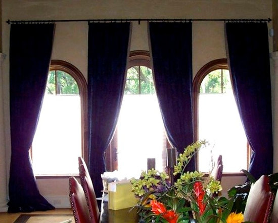 Drapery Ideas - Arched windows with functional drapery panels.