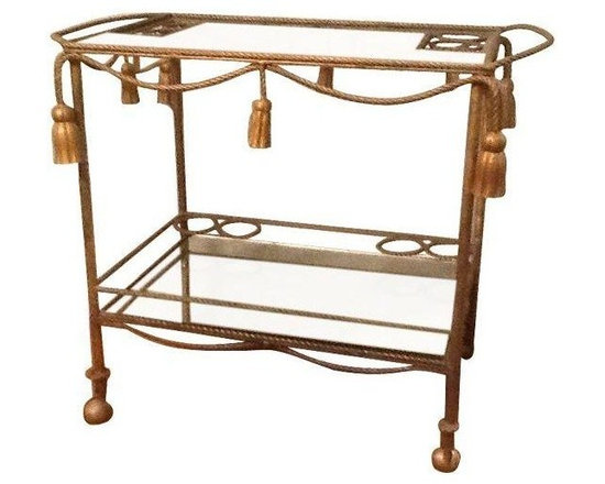Pre-owned Italian Rope and Tassel Bar Cart - This elegant bar cart is simply gorgeous. Gilt tole rope and 8 delicate tassels adorn this 4-wheel rectangular cart. There are 4 bottle holders on the top and 8 on the bottom. The top is clear glass, with no scratches or nicks, and the bottom holds an exquisite mirrored glass. Similar pieces have been dated to the 1950s.