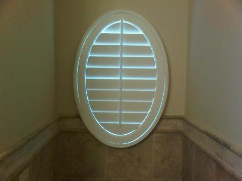 Oval window covering traditional bathroom by for Window treatment for oval window