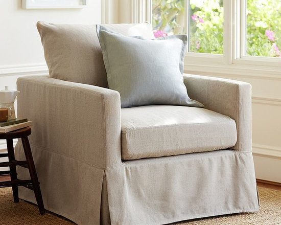 CATALINA SLIPCOVERED ARMCHAIR - A style-conscious silhouette plus the convenience of slipcovers offers everyday pleasure with our Catalina Collection. The slender arms of this sink-in armchair makes it great for more compact spaces.