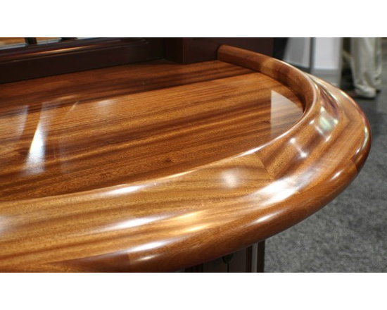 Sapele Mahogany Bar Top with Chicago Bar Rail. Designed by Vincent Cappello, Put -