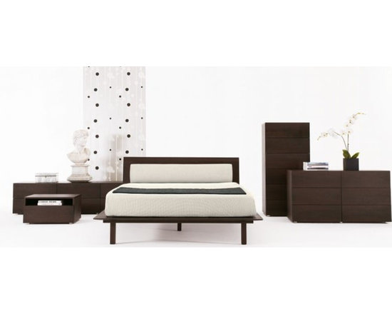 Zola Bed - Design Within Reach - There is some sort of principal of Feng Shui that advocates keeping the area underneath your bed cleared out. That is easy to accomplish with the Zola platform bed. Also, it's a few inches higher than most platform beds, making it less of a challenge to roll out of it and onto your feet when that alarm clock starts to screech.