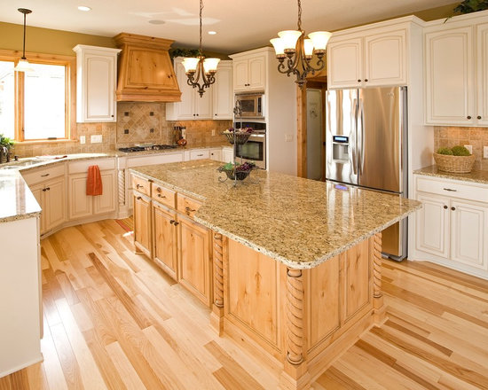 Custom Cabinets - Kitchen with painted white perimeter and natural knotty alder island and a custom wood hood