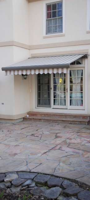Striped Awnings by Breslow traditional-patio