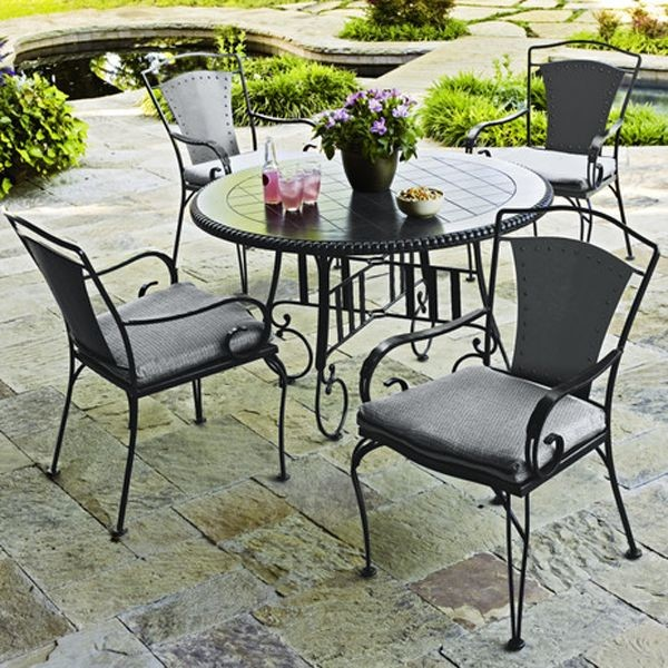 Wrought iron outdoor dining table and chairs for Metal patio table and chairs set
