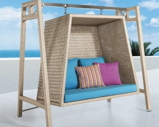 Tiki Rattan Hammock Set - Bring a comfortable, durable, and distinctive addition to your patio decor with this Tiki Rattan Hammock Set.
