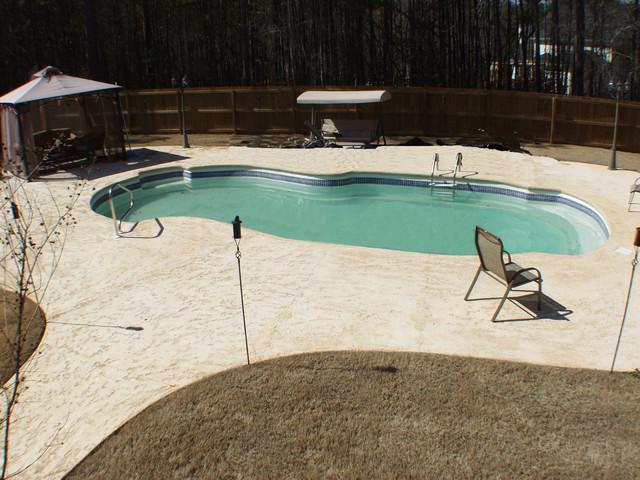 Custom Pools & Palms traditional