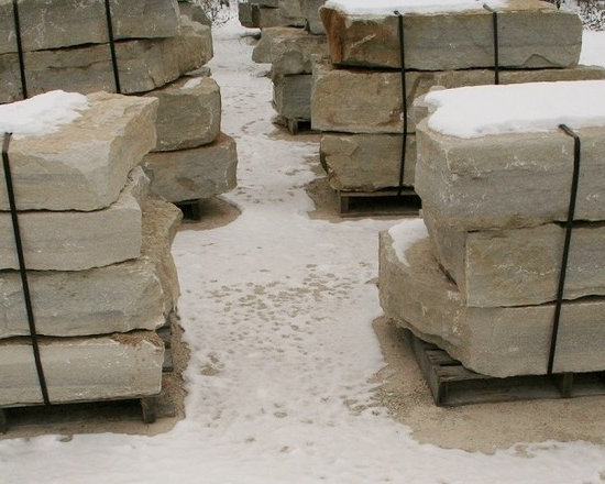 Standard Outcroppings - The faces of our Standard Outcropping stone are dictated by where the stone cracks as it's quarried, leading to a relatively smooth, yet natural stoneface. This stone is available in soft shades of grey with attractive, subtle blue undertones, and it's easily stackable, making it a wonderfully easy-going companion in almost any landscaping project.