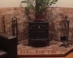 install free standing fisher wood heater in our small living room