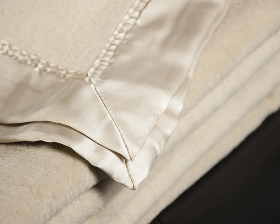 None - Aus Vio Mulberry Silk Throw Blanket - Sleep in luxury and comfort with the Aus Vio throw blankets available in a dawn,pebble and iris finish. Constructed of a 100-percent mulberry silk,these pieces are machine washable for easy care and repeated use.