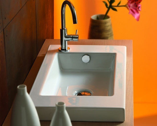 "Self Rimming White Ceramic Bathroom Sink By Tecla - Self rimming bathroom sink with overflow. Sink features one faucet hole (as shown). Sink is made of high-quality white ceramic. Sink dimensions: 23.6"" x 13.8"""