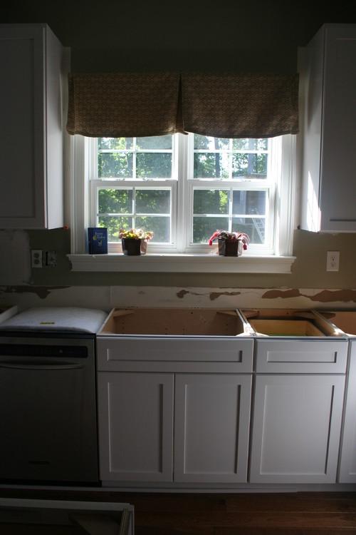 Kitchen sink not centered w window which sink will for Window under kitchen cabinets