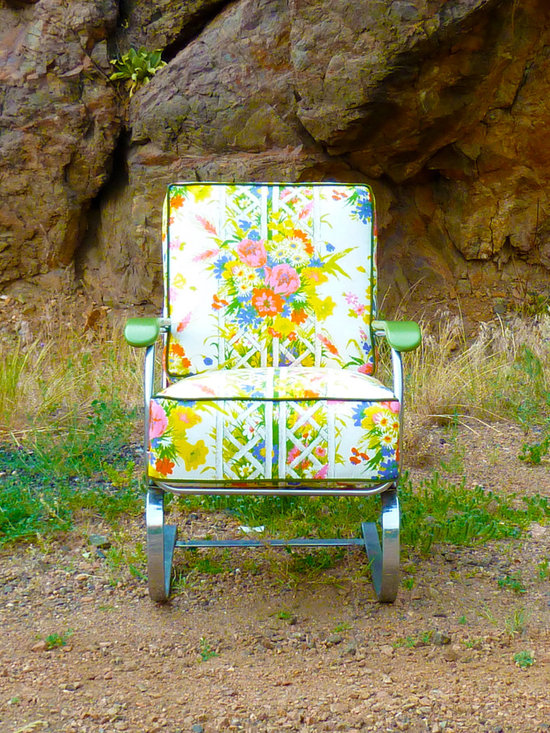 Vintage Furniture Redesigned - This Lloyd Loom Product (part of Heywood Wakefield) chrome rocking chair is been covered in two removable vintage floral cushions displaying beautiful flower bouquets in green, pink, yellow, purple, and ivory. Each cushion has a zipper opening and is finished with green corduroy welt cord. Great for the sun room, covered porch, kids room, library, or bedroom, this rocker gives you instant boho style from the Art Deco period!