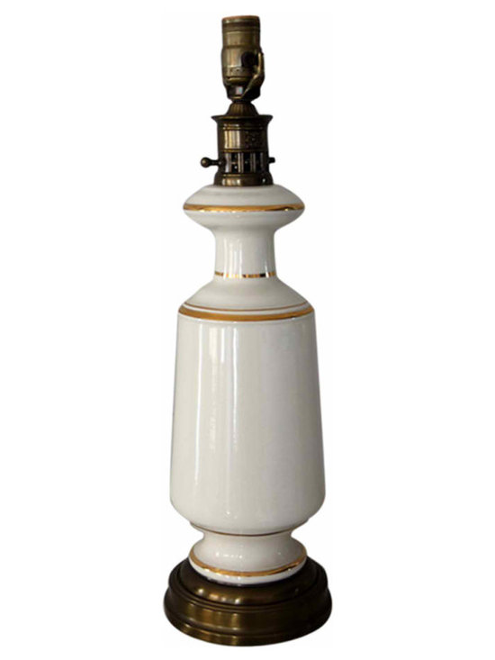 White and Gold Glass Lamp - Hollywood Regency style gold and white glass table lamp. Gold trim in excellent condition adds the perfect touch to this simple, classic lamp.