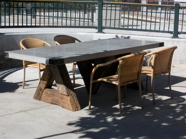 triangle table with concrete top eclectic dining room