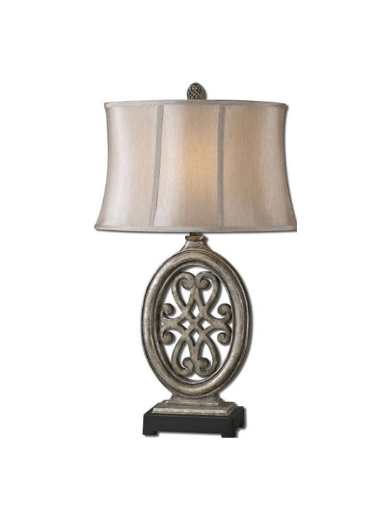 Uttermost Barela - Heavily distressed antiqued silver leaf finish accented with a matte black foot. The oval semi-bell shade is a silken champagne bronze fabric.