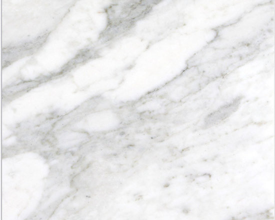 Marble Calacatta Michelangelo Tile - CANVAS WHITE BACKGROUND WITH GREY SPECKLES BLANKET ACROSS  A SOLID BACKDROP OF SOFT TAN.