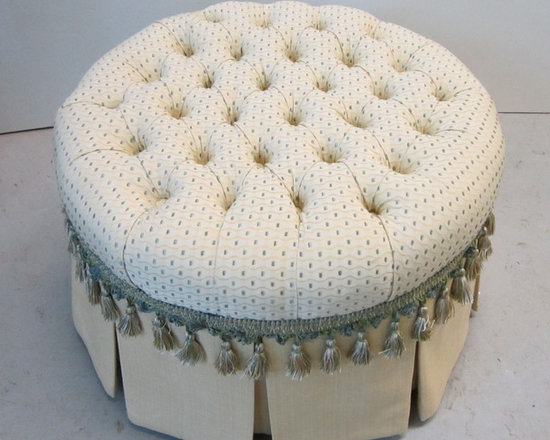 new build ottoman - ...and top attached to skirted base in contrast fabric solid.  decorative fringe applied around the circumference of the ottoman top