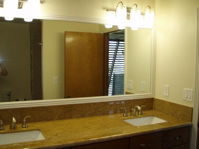 Custom granite with undermount sink and Kohler fixtures tropical-bathroom