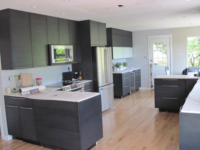 Black Oak Flat Panel Cabinets contemporary-kitchen-cabinetry