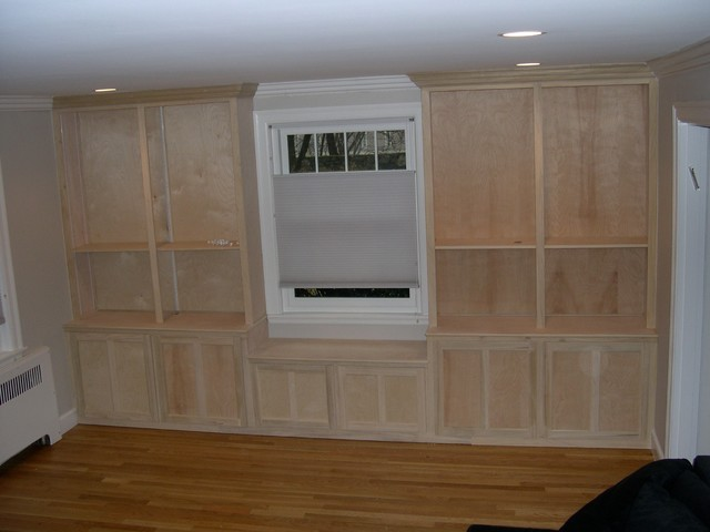 window seat with built in cabinets and shelving