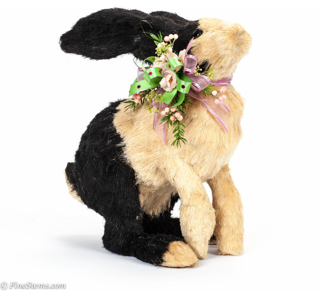 Large black and white sisal rabbit with spring silk floral traditional-holiday-decorations